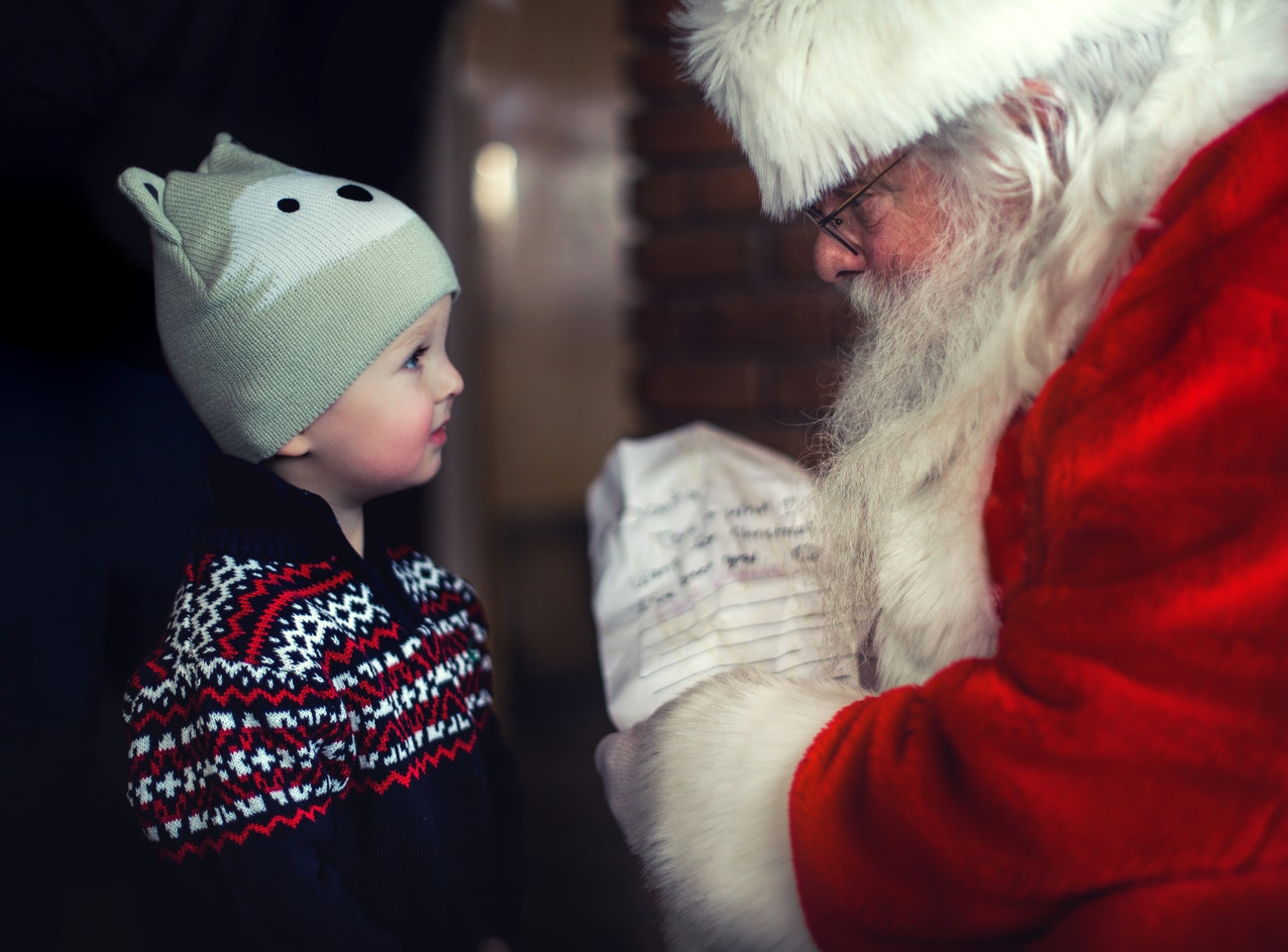 Santa Giving presents in a Grotto